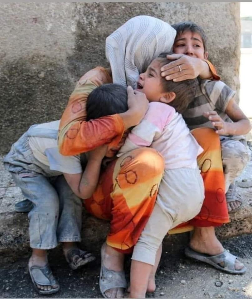 A Woman Hugging Crying Kids
